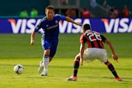 Chelsea's Frank Lampard (L) and AC Milan's Urby Emanuelson during their exhibition match in Miami on July 28. Emanuelson scored in the 68th minute as AC Milan edged Champions League winner Chelsea 1-0 in an exhibition contest at Sun Life Stadium