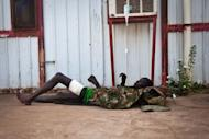 A wounded soldier of the South-Sudan's Sudan People's Liberation Army (SPLA) rests outside the Rubkona Military Hospital in Rubkona, South Sudan. Sudanese forces killed hundreds of South Sudanese during a days-long battle for Sudan's most important oil field Heglig, a senior official said Sunday