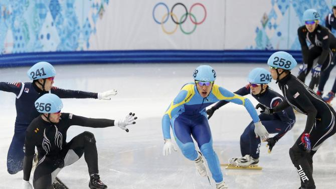 Kazakhstan's Zhumagaziyev passes U.S. and South Korean skaters during the men's 5,000 metre short track speed skating relay semi-final event at the Iceberg Skating Palace during the Sochi 2014 Winter Olympics