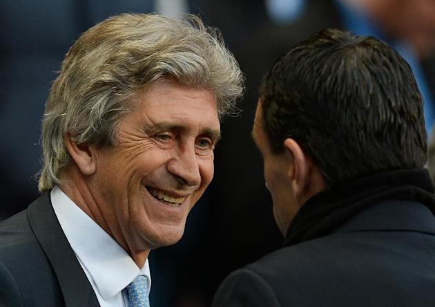 Manchester City's manager Manuel Pellegrini (L) chats with Sunderland's manager Gus Poyet before their English Premier League match, at the Etihad Stadium in Manchester, on April 16, 2014