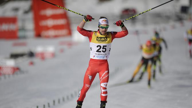 Pittin of Italy crosses the finish line in third place in the final World Cup Nordic Combined event of the season in Oslo