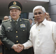Chinese Defense Minister Liang Guanglie, left, shakes hands with his Philippine counterpart Voltaire Gazmin at the Defense Headquarters in suburban Quezon City, north of Manila, Philippines on Monday May 23, 2011. Guanglie's visit comes amid renewed tension over the disputed Spratly's Islands which are claimed by China, Philippines and four other asian countries and terrotorites. Washington has expressed concerns that the disputes could hamper access to one of the world's busiest commercial sea lanes.