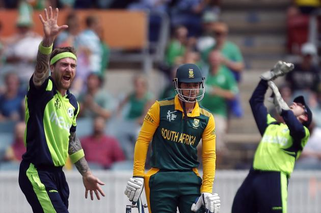 Ireland's John Mooney and Gary Wilson appeal successfully for the wicket of South Africa's Quinton de Kock the Cricket World Cup match in Canberra