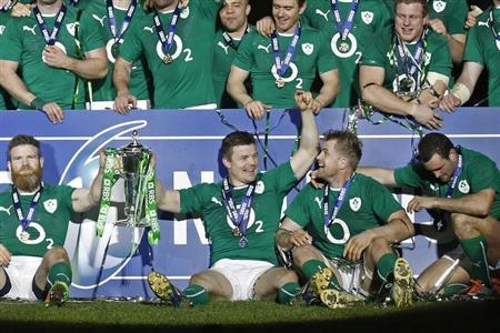 Ireland's Brian O'Driscoll is cheered by teammates after his team defeated France in their Six Nations rugby union match at the Stade de France in Saint-Denis, near Paris