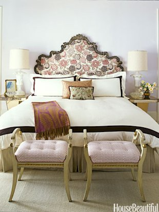 bed with ornate headboard