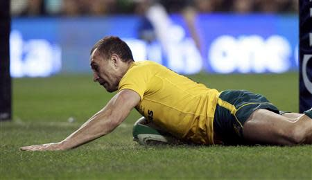 Australia's Cooper scores against Ireland in their International rugby union match in Dublin