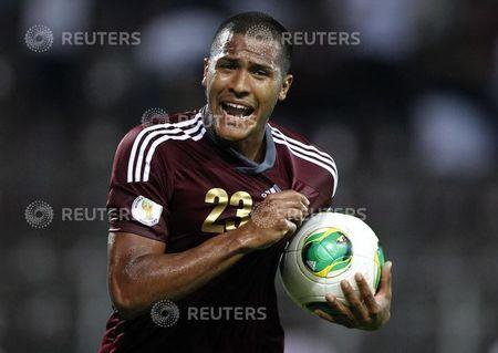 Venezuela's Rondon celebrates scoring against Peru during their 2014 World Cup qualifying soccer match in Puerto La Cruz