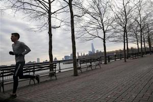 A man jogs along the waterfront in Hoboken, New Jersey