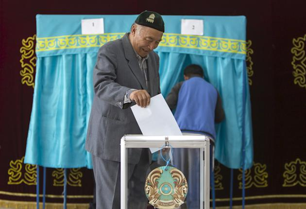 A man casts his ballot during a snap presidential election in the village of Tuzdybastau, Kazakhstan