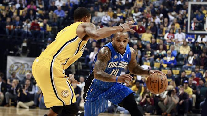 Orlando Magic guard Jameer Nelson, right, advances the basketball around Indiana Pacers guard George Hill in the first half of an NBA basketball game in Indianapolis, Tuesday, Oct. 29, 2013