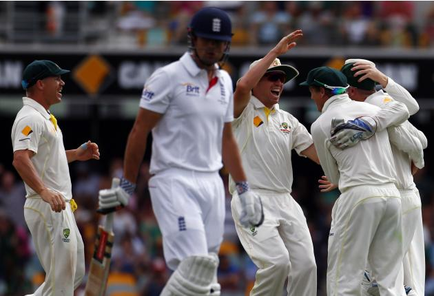 Australia's Warner and Siddle celebrate with Bailey and Haddin after taking the wicket of England's captain Cook during the fourth day's play of the first Ashes cricket test match in Brisb