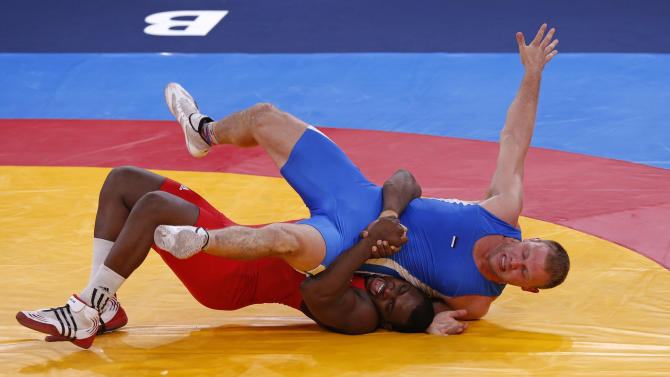 Cuba's Mijain Lopez Nunez fights with Estonia's Heiki Nabi on the final of the Men's 120Kg Greco-Roman wrestling at the ExCel venue during the London 2012 Olympic Games