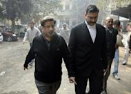 Rajesh Talwar (L), father of murdered teenager Aarushi, arrives for a hearing the Ghaziabad court, in Ghaziabad in 2011. A murder case that has obsessed India for four years will come to court on Friday when a middle-class couple from Delhi stand trial on charges of killing their teenage daughter and domestic servant