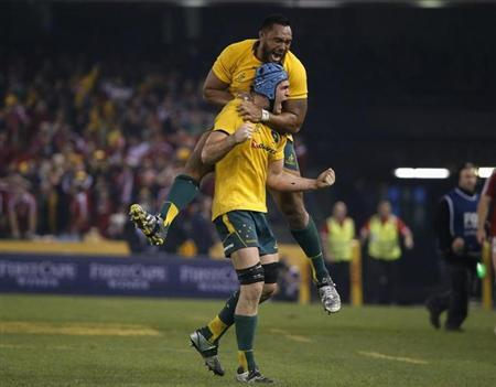 Australia Wallabies' Sekope Kepu celebrates with teammate and captain James Horwill after winning their rugby union test match against the British and Irish Lions in Melbourne