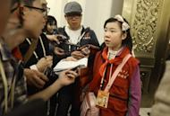 This picture taken on November 9 shows Sun Luyuan, a Beijing sixth-grade student being interviewed at the Great Hall of the People during the 18th National Congress of the Communist Party of China in Beijing. Chinese officials accustomed to the tame questions of a compliant state press were caught out by a plucky 11-year-old reporter during the country's sensitive Communist Party congress