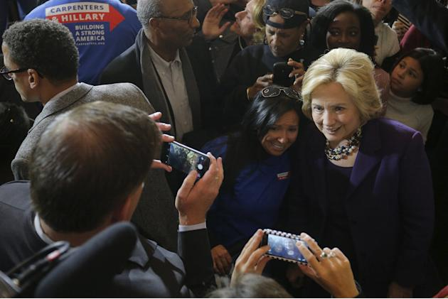 U.S. Democratic presidential candidate Hillary Clinton poses for a photograph with audience members during a campaign rally with labor unions at Faneuil Hall in Boston