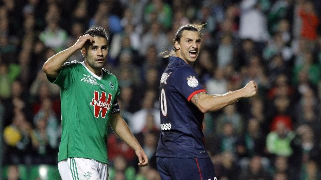 Paris Saint Germain's Zlatan Ibrahimovic celebrates after the team score against Saint-Etienne during their French League One soccer match in Saint-Etienne, central France, Sunday, Oct. 27, 2013