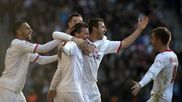 MK Dons celebrate scoring against AFC Wimbledon