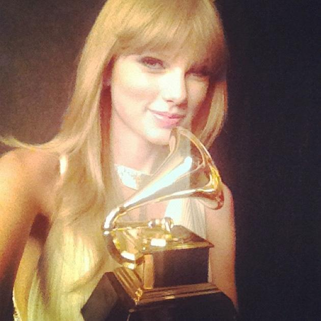 Backstage at the Grammys 2013: Taylor Swift won the Grammy for Best Song Written for Visual Media. She posed with her award for a Twitpic after arriving home. Copyright [Taylor Swift]