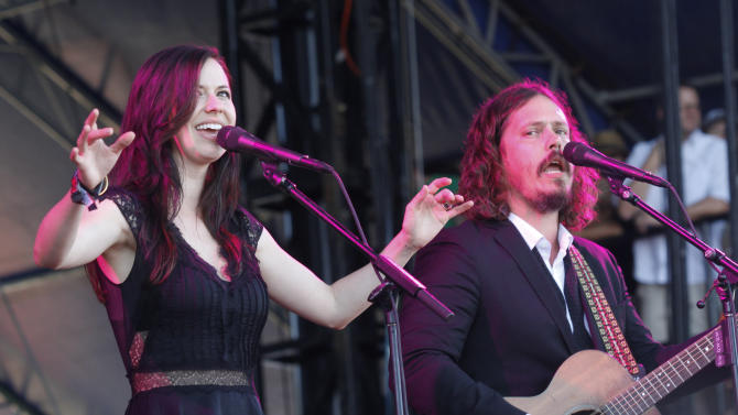 "FILE - This Oct. 14, 2012 file photo shows Joy Williams, left, and John Paul White of The Civil Wars at the Austin City Limits Music Festival in Austin, Texas. Grammy-winning duo The Civil Wars are calling off their upcoming tour dates, citing irreconcilable differences. Folk-pop duo Joy Williams and John Paul White released a statement Tuesday announcing that they are ""unable to continue as a touring entity at this time"" due to ""internal discord and irreconcilable differences of ambition."" Williams and White are both married, but to other people. Williams recently had a baby with husband and manager Nate Yetten. (Photo by Jack Plunkett/Invision/AP, file)"