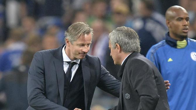 Schalke head coach Jens Keller, left, congratulates Chelsea's manager Jose Mourinho after the Champions League group E soccer match between FC Schalke 04 and Chelsea FC in Gelsenkirchen, Germany, Tuesday, Oct.22,2013