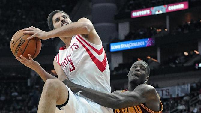 Houston Rockets' Omri Casspi (18) is fouled by Cleveland Cavaliers' Anthony Bennett (15) in the second half of an NBA basketball game Saturday, Feb. 1, 2014, in Houston. The Rockets won 106-92