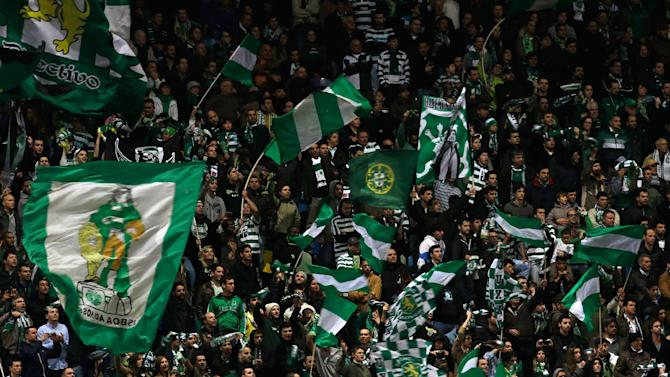 Sporting supporters cheer in the stands during their Portuguese league soccer match against  Belenenses Saturday, Dec. 14 2013, at Sporting's Alvalade stadium in Lisbon. Sporting defeated Belenenses 3-0 to remain at the top of the table