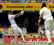 South African batsman Alviro Petersen (L) plays the ball to the boundary for four runs off Australian bowler James Pattinson (R) during their first cricket Test at the Gabba ground in Brisbane, on November 9