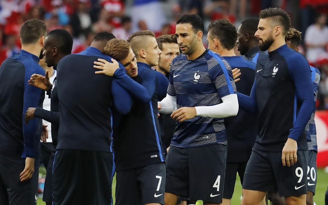 France's Adil Rami (C), and Antoine Griezmann and Olivier Giroud before the game
