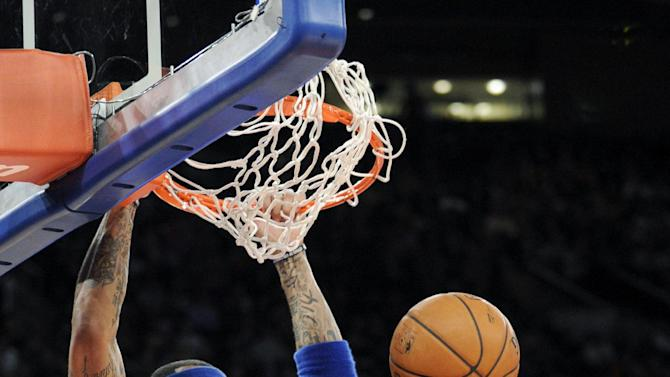 New York Knicks' Kenyon Martin dunks the ball during the second quarter of an NBA basketball game against the Orlando Magic, Friday, Dec. 6, 2013, at Madison Square Garden in New York
