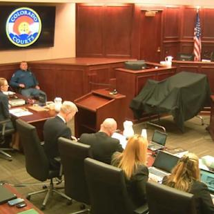 Judge Carlos A. Samour Jr., top right, presides over the opening of the trial of Colorado theater shooter James Holmes, far left, in Centennial, Colo., Monday, April 27, 2015. The trial will determine if he'll be executed, spend his life in prison, or be committed to an institution as criminally insane. (Colorado Judicial Department via AP, Pool)