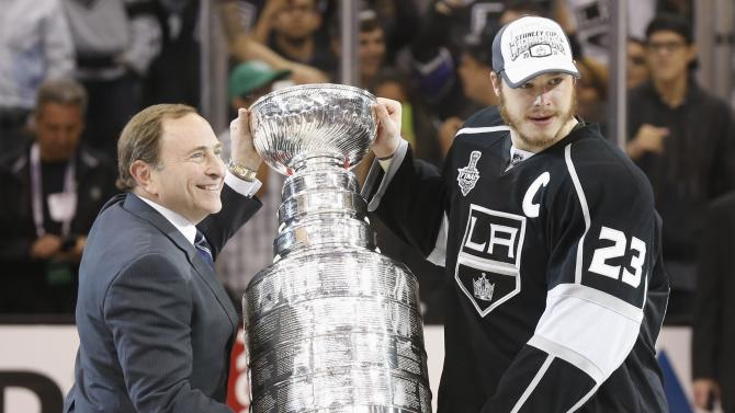 Los Angeles Kings' Dustin Brown is presented with the Stanley Cup after NHL Stanley Cup Finals in Los Angeles