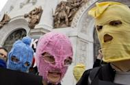 """Supporters of punk group """"Pussy Riot"""" wear the band's trademark coloured balaclavas during a protest outside the Church of Christ the Saviour in central Moscow. Russian police arrested four activists during the demonstration"""