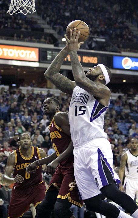 Sacramento Kings center DeMarcus Cousins, right, goes to the basket against Cleveland Cavaliers forward Luol Deng, left, of the Sudan during the third quarter of an NBA basketball game in Sacramento,