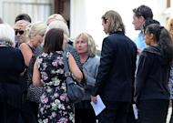 "June Steenkamp (C), mother of the late South African model Reeva Steenkamp, stands during the funeral ceremony at the crematorium building in Port Elizabeth on February 19, 2013. ""I just want to finish mourning my daughter. I will have to get used to life without her,"" Steenkamp told the Afrikaans-language daily Beeld, adding that she had ""cried out all my tears"""