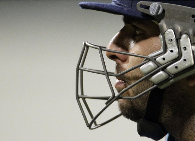 India's batsman Yuvraj Singh looks on  as he leaves the field after being dismissed by South Africa's bowler Morne Morkel, unseen, for 2 runs during the first One Day International cricket match again