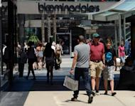 Shoppers walk through the Santa Monica Place mall in California. US consumer spending picked up pace in September, sustaining a three month surge that also represents a downturn in household saving, the Commerce Department reported Monday