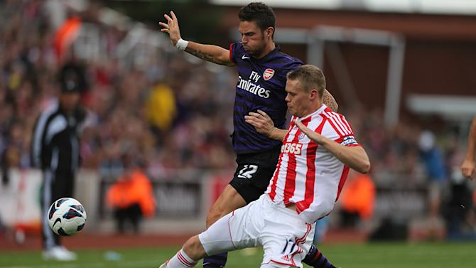 Ryan Shawcross, right, and Olivier Giroud, left, battle for the ball