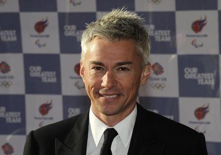 Former British Olympic athlete Jonathan Edwards poses for photographers as he arrives for the 'Our Greatest Team Rises' event at the Royal Albert Hall in central London