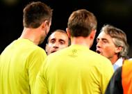 Roberto Mancini confronts the officials after City's Champions League match against Ajax in Manchester on November 6. A 2-2 home draw to Ajax all but ended City's hopes of reaching the Champions League group stages and Mancini's frustration was clear when he confronted the referee