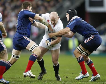 England's Cole is tackled by France's Pape and Picamoles during their Six Nations rugby union match at the Stade de France in Saint-Denis, near Paris