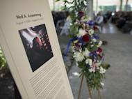 A memorial tribute from the Smithsonian is seen at the entrance of a private memorial service celebrating the life of Neil Armstrong, Aug. 31, 2012, at the Camargo Club in Cincinnati. Armstrong, the first man to walk on the moon during the 1969