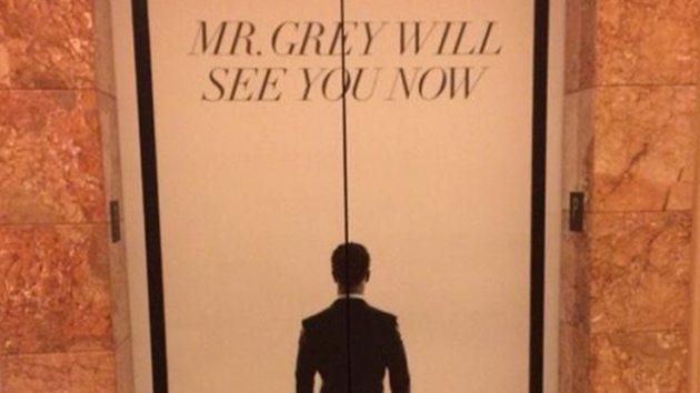 A 'Fifty Shades' poster on an elevator at CinemaCon -- Access Hollywood