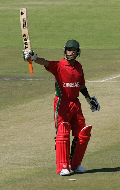 Zimbabwe batsman Sikanda Raza Butt waves to the crowd after reaching 50 runs during the first of the five ODI cricket series matches between India and hosts Zimbabwe at the Harare Sports Club on July