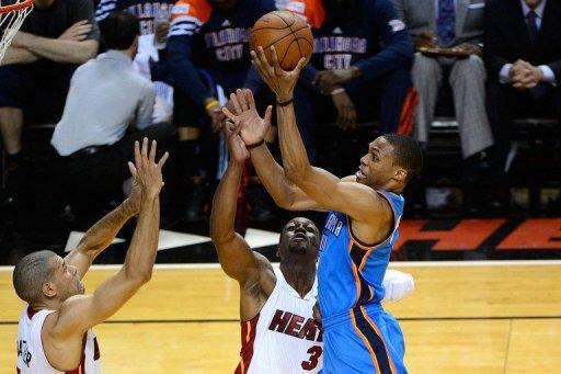 Oklahoma City Thunder guard Russell Westbrook (R) finished with a game-high 43 points