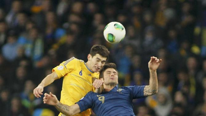 Ukraine's Taras Stepanenko goes for a header with France's Olivier Giroud during their 2014 World Cup qualifying first leg playoff soccer match at the Olympic stadium in Kiev