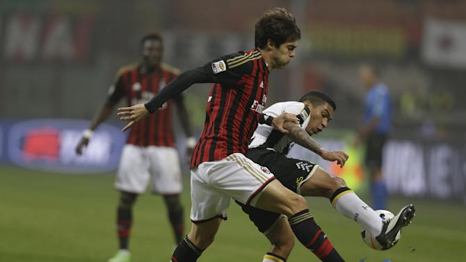 AC Milan Brazilian forward Ricardo Kaka', right, challenges for the ball with Udinese defender Allan Loureiro Marquez of Brazil, during a Serie A soccer match between AC Milan and Udinese, at the San Siro stadium in Milan, Italy, Saturday, Oct. 19, 2013