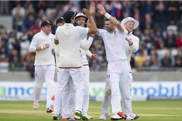 England's James Anderson, centre right, celebrates with teammates after taking the wicket of Australia's Michell Marsh, caught by Jos Buttler for 0 on the first day of the third test match of