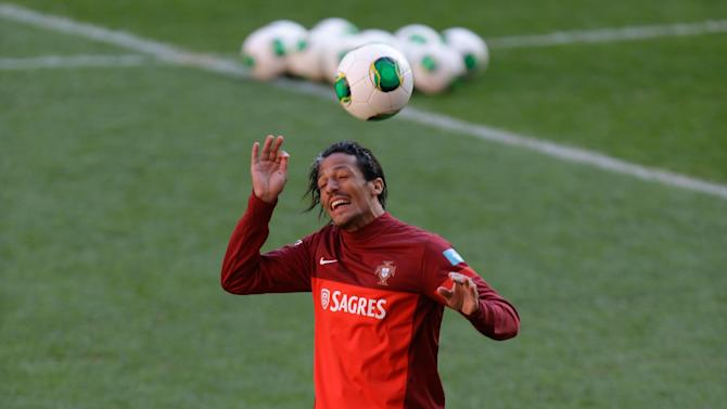 Portugal's Bruno Alves heads a ball during a training session Sunday, Nov. 17 2013, at the Luz stadium in Lisbon. Portugal will play Sweden Tuesday in a World Cup qualifying playoff second-leg soccer match