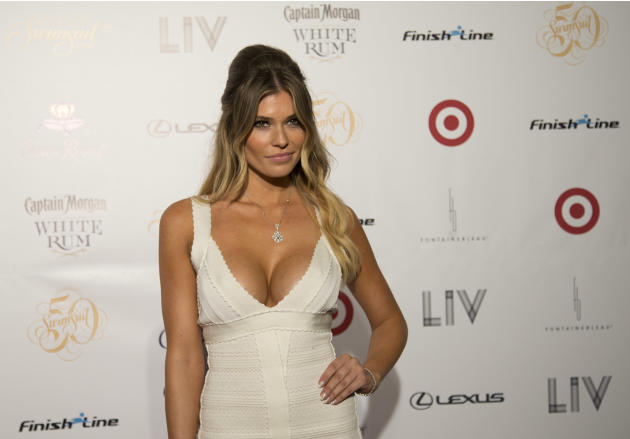 Model Samantha Hoopes poses for photos, Wednesday, Feb. 19, 2014 in Miami Beach. Several 2014 Sports Illustrated models walked the red carpet to celebrate the 50th Anniversary of the Sports Illustrate